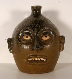 24: Lanier Meaders. Canon Ball Rock Tooth Face Jug. : Lot 24