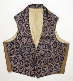 Waistcoat Date: 1840s Culture: British Medium: silk Waistcoats of this time feature a cotton back with a buckle closure. Fronts were usually brightly colored silks and embroidered, and still the focus of men's outfits.