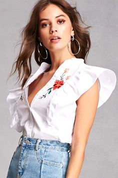 A woven top featuring an ornately embroidered floral chest design, a mock neckline, button-up front, cap sleeves cascading into a ruffled front, and a tailored silhouette.<p>- This is an independent brand and not a Forever 21 branded item.</p>