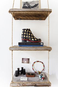 Handmade shelf with rope and pieces of reclaimed barn wood