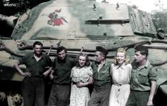 The crew of a King Tiger pose with girlfriends. The insignia on the tank has been duplicated in Tamiya Model Kits featuring the King Tiger