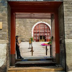 The entrance to the Beijing Bell Tower. As I walked by I noticed the gate guard standing in profile against the wall of the gate. He tried to hide from me so we played a little game of cat and mouse and I won 😀. #China #streetphotography #street #story #storytelling #visualstorytelling #storyteller #blackandwhite  #Bnw #blackandwhitephotography #bnwlife #bnw_life # # #documentary #documentaryphotographer #documentinglife #beijing #visitchina #hutong #stories #travel #traveldeeper…