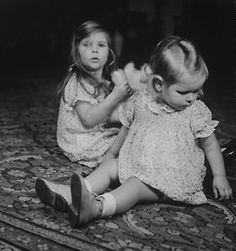 Helga & Hilde Goebbels, young daughters of Nazi Propaganda Min. Joseph Goebbels, sitting on rug & playing w. toy w. their older half-brother Harald Quandt (from mother's previous marriage) at home, taken by Roger Schall.