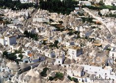The Trulli of Alberobello are part of the UNESCO World Heritage. The trulli , limestone dwellings found in the southern region of Puglia, are remarkable examples of drywall (mortarless) construction, a prehistoric building technique still in use in this region.