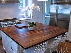 Walnut edge grain wood island countertop.