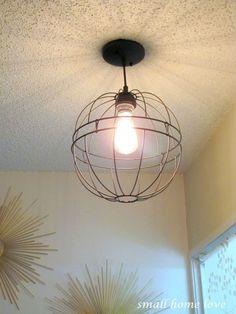 DIY industrial ceiling fixture using hanging garden baskets.MATT, we're doing this! Ceiling Fixtures, Light Fixtures, Ceiling Lights, Home Lighting, Pendant Lighting, Chandelier, Orb Light, Light Bulb, Garden Basket