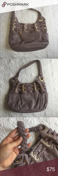 """Lavender/Gray Leather Michael Kors Shoulder Bag Lovely Soft Lavender/Gray Leather Michael Kors Shoulder Bag! In EUC, no marks or scuffs, interior like new! Beautiful braided shoulder strap, braided/woven leather details through gold hardware. This is not a big bag, I'm very petite so it looks good on a smaller frame. Bag measure approximately 13"""" w x 8"""" h and shoulder strap is 20"""" total. Michael Kors Bags Shoulder Bags"""