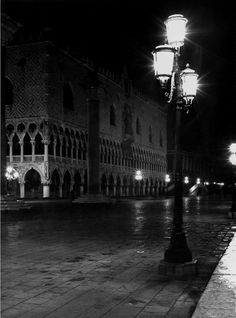Dmitri Kessel: Night lit by elegant street lights in a flooded Piazza San Marco next to the Doge's Palace after a heavy rain. Venice, Italy, 1952