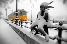 Yellow Budapest Tram Bronze statue on the Danube Bank in the snow - Kiskiralylany [Little Prince[ by Laszlo Marton 1989