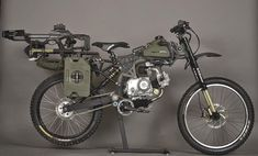 Survival Bike by Motopeds Accessories list: ----------------------------- - Barnett Recruit Compound Crossbow - Rotopax RX-1G Gas Packs - 1 Gallon - United Cutlery M48 Tactical Survival Shovel - United Cutlery M48 Hawk Tomahawk - United Cutlery M48 Hawk Har