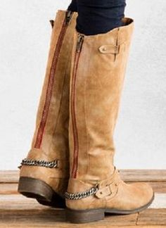 tall, blond riding boots with back zipper