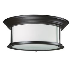 Slim detailing and a wide, cylindrical matte opal glass shade completes the look of this traditional yet current ceiling lamp. This two-light fixture also offers an eye-catching bronze finish that blends with most decor.