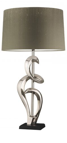 Love the movement in this lamp. Match it with another that doesn't have the same exact design and replace with plum shade.