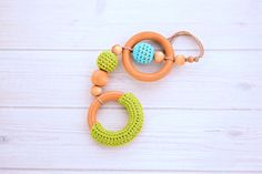 Beautiful hardwood Maple baby teething toy with crocheted over wood beads. Each wooden teething ring toy features two 3 natural maple wooden Handmade Wooden Toys, Wooden Baby Toys, Baby Teething, Teething Toys, Wooden Teething Ring, Shower Bebe, Baby Gym, Wooden Rings, New Baby Gifts