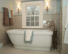 Like the tan subway tile...maybe laundry room, kitchen back-splash or downstairs bathroom?