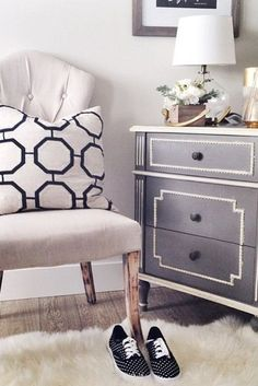 Style an empty corner with a pretty tufted chair, fluffy rug, and a simple chest of drawers to create a relaxing nook.
