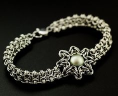 Our Enya Bracelet it a unique and original design combining a traditional and a fresh chainmaille pattern and finishing it with a lovely