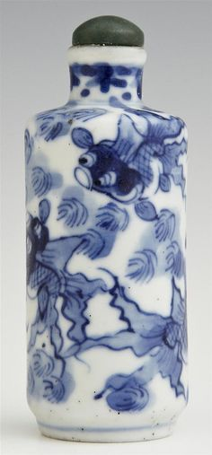Chinese Blue and White Porcelain Snuff Bottle, 19th c., decorated with Koi fish, with a jade stopper, H.- 3 3/16 in., Dia.- 1 1/4 in.