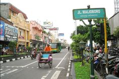Jalan Malioboro or Malioboro Street is a major shopping street in Yogyakarta, Indonesia; the name is also used more generally for the neighborhood around the street. The street is the centre of Yogyakarta's largest tourist district surrounded with many hotels and restaurants nearby. Sidewalks on both sides of the street are crowded with small stalls selling a variety of goods. http://www.goindonesia.com/id/indonesia/jawa/yogyakarta/obyek_wisata_yogyakarta/jalan_malioboro
