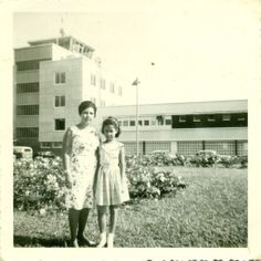 Mom (with our cousin Jewel-Ann) at Piarco Airport, getting ready to board the flight for her and Daddy's jaunt to London and Europe (1964)