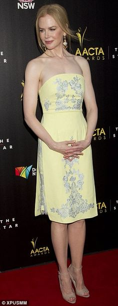 No jet lag here! Nicole Kidman lights up the AACTA Awards in a yellow dress…