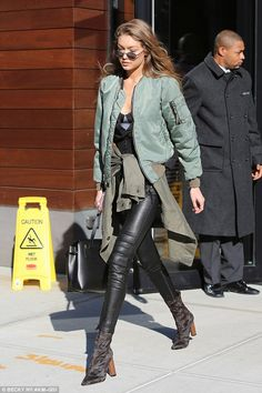 Don't forget your khakis! Gigi Hadid puts on a leggy display in green #dailymail