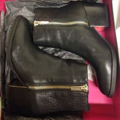 Vince camuto black leather ankle boots Used as store displays, Vince camuto black leather ankle boots. In excellent condition! Comes with box Vince Camuto Shoes Ankle Boots & Booties