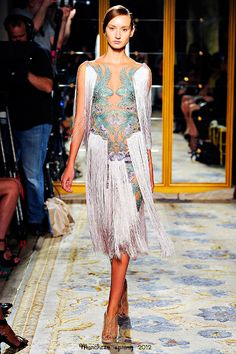 """Marchesa collection. Dress inspired by Ernst Haeckel (February 16, 1834 – August 9, 1919) who was a German biologist, naturalist, philosopher, physician, professor and artist. The published artwork of Haeckel includes over 100 detailed, multi-colour illustrations of animals and sea creatures (inbcluding Kunstformen der Natur, """"Art Forms of Nature"""")."""