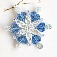 https://flic.kr/p/AzRmiS | 6 point blue and white quilled snowflake with silver glitter and silver diamante