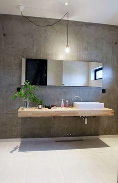Een mooie interieur trend is beton in de badkamer. Het is duurzaam, gemakkelijk in onderhoud en het geeft de badkamer een stoere look. Bekijk voorbeelden