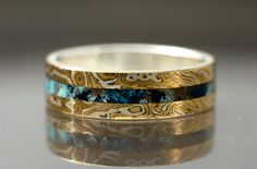 Mokume gane shattuckite inlay ring; Christopher Timberlake is great to work with for custom made wedding bands or engagement rings. He takes your lifestyle into consideration when designing his rings and really listens to what you're looking for in a piece of jewelry.