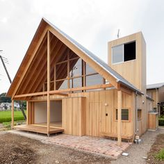 Surrounded by farmland in rural Japan, this house by architecture studio Tailored Design Lab features a steeply pointed roof that frames landscape views