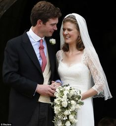 9-14-13 Laura Marsham, the daughter of the 8th Earl of Romney. married James Meade, son of British equestrian Richard Meade.All smiles! The couple looked overjoyed after tying the knot in the beautifully decorated church, whose entrance was elaborately covered in cream flowers