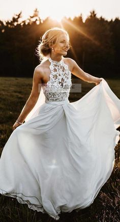 This is a long chiffon beach wedding dress with lace. It is a sleeveless wedding dress. Silhouette:A-Line Hemline/Train:Sweep Train Neckline:Halter Fabric:Chiffon Embellishment:Lace Sleeve Length:Sleeveless Waist:Natural Back Style:Zipper-Up Country Wedding Dresses, Long Wedding Dresses, Bridal Dresses, Bridesmaid Dresses, Wedding Gowns, Maxi Dresses, Sequin Bridesmaid, Wedding Ceremony, Bridesmaids
