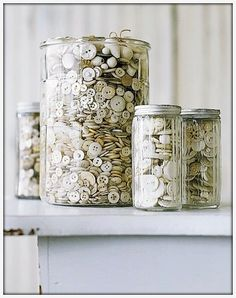 Separate all my buttons by color and store on a shelf in assorted clear glass jars.  Decorative and so colorful!