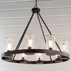Kitchen Lighting Ideas Round Industrial Indoor/Outdoor Chandelier - Outdoor living spaces deserve stylish lighting like this Round Industrial Chandelier. The lights are on full display, but protected by clear cylindrical shades. Dining Chandelier, Round Chandelier, Dining Light Fixtures, Kitchen Lighting Over Table, Farmhouse Light Fixtures, Kitchen Chandelier, Outdoor Light Fixtures, Trendy Farmhouse Kitchen, Farmhouse Kitchen Lighting