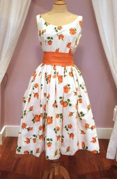 This dress is fabulous! 1950s Vintage Ivory Cotton Full Skirt Sundress with Orange Rose Design