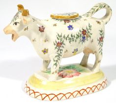 Staffordshire cow creamer and lid with hand painted floral decoration and floral moulded base, high. Cow Kitchen Decor, Kitchen Art, Cow Creamer, Carlton Ware, Architectural Antiques, Cream And Sugar, Sam Heughan, Vintage Glassware, Coffee Break