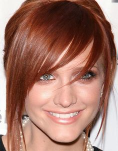 I secertly always wished I was a red head. (I've got the temper for it. lol) Got to dye my hair this color sometime!