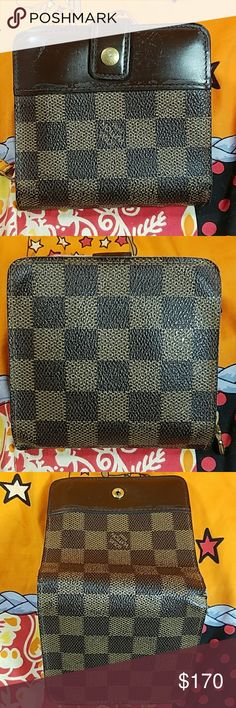 Authentic Louis Vuitton Damier Bifold Wallet The outer canvas is in good condition. The brown leather trim has a lot of dark marks (1st picture). There is a little crook on the right bottom. Inside is nice and clean for a pre-owned wallet. Inside coin pocket showed a little wearing. 5 Ccard slots, bill & coin pockets. Date code # CA0053. It made in France. Dimension:( about)4, 4.25, .5. No trade please. Louis Vuitton Accessories