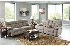 "The Overly Reclining Loveseat with Console from Ashley Furniture HomeStore (AFHS.com). The ""Overly-Smoke"" upholstery collection features the comfort of plush pillow top arms and the support of the tufted back cushioning all wrapped up in an exciting contemporary design that is sure to awaken the décor of any living area."