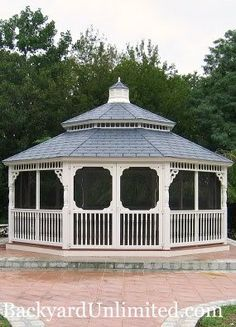 20' Vinyl Colonial Style Octagon Gazebo with Victorian Braces, Screen Package, Rubber Slate Pagoda Roof, and Cupola http://www.backyardunlimited.com/gazebos