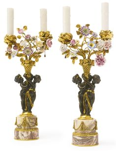 EDWARD F. CALDWELL & CO 1851-1914 A PAIR OF GILT AND PATINATED BRONZE TWIN-LIGHT CANDELABRA NEW YORK, EARLY 20TH CENTURY raised on a fleur de pêcher marble base and mounted with porcelain flowers height 19 in. 48 cm