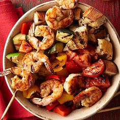 With the addition of grilled shrimp and some fresh vegetables, a classic Italian salad becomes an easy dinner recipe.