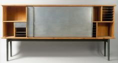 Cabinet on base, ca. 1939  Charlotte Perriand (French, 1903–1999)  Aluminum, pine, and walnut