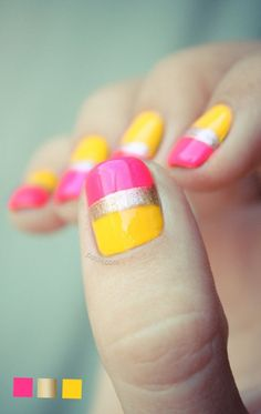 A fruity and adorable colored French tip using bright yellow and pink polish topped with a metallic gold strip.