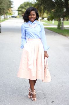 Sabine from The B.Stinger is looking pretty in pastels. She styles our blush taffeta midi skirt with a light blue button down. She adds some matching blush accessories to polish off her look | Banana Republic