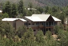 Spence Residence, White Mountain Estates, Ruidoso, NM. This is western mountain style home has spectacular views to Sierra Blanca mountain with heavy timber trusses, two kitchen islands, and an elevator to a full basement. A two-level deck spans the full length of the house in back.