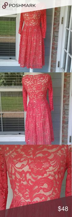 Dress Coral laced beauty, beige full lining with laced only sleeves, hidden back zipper,this is one of my very favorite Posh dresses, only giving it up because I've gained a few pounds. This dress is absolutely elegant,it is 37 inches long,and 17inches pit to pit,no belt incld Eliza J Dresses