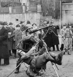 Wehrmacht (Heer) soldier using his body weight to stabilize an MG-34 on an tripod